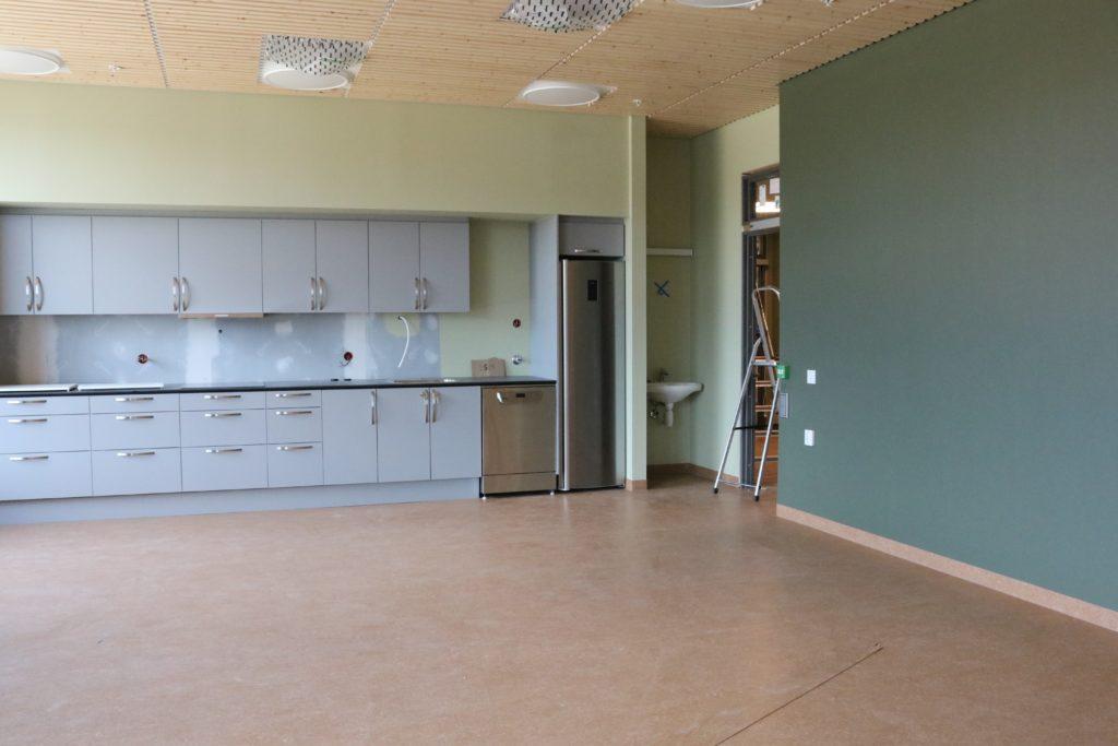 bilde av kjøkken med grønne vegger